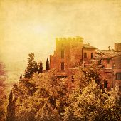 Grunge image of historical building in Tuscany at sunset.