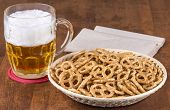 stock photo of stein  - A stein of beer and a bowl of pretzels - JPG