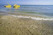 Yellow Lifeboat On The Beach.
