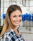 Closeup portrait of female customer smiling in hardware shop