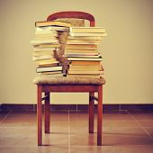 some piles of books on a chair, with a retro effect