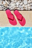 Flip flops by the poolside with water and copy-space