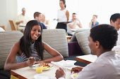 Couple Enjoying Breakfast In Hotel Restaurant