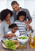 Affectionate Family Preparing Salad Together