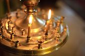image of church interior  - Burning candles in a Russian ortodox church. Close-up of ordinary church interior. Selective focus. ** Note: Visible grain at 100%, best at smaller sizes - JPG