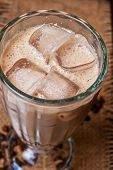 Iced coffee closeup at table