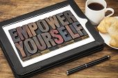 empower yourself - motivation concept - text in vintage letterpress wood type blocks stained by ink