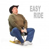 Overweight cowboy riding on a rocking horse. Picture with space for your text.