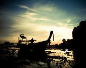Silhouette of longtail boat at sunset at Railay beach, Thailand