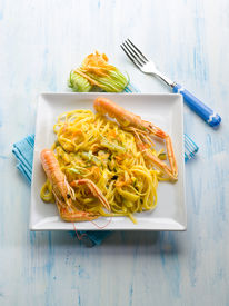 image of norway lobster  - pasta with norway lobster zucchinis flower and saffron - JPG