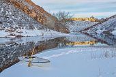 decked expedition canoe on icy shore  of Horsetooth Reservoir near Fort Collins in northern Colorado, winter scenery