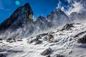 picture of blown-up  - Snow is blown up the slopes of the Jade Dragon Snow Mountain - JPG