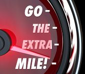 picture of extend  - Go the Extra Mile words on a speedometer with needle racing to illustrate extended effort in driving - JPG