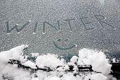 Smiley Drawn On Snowy Windshield