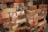Pile of reclaimed old building bricks.