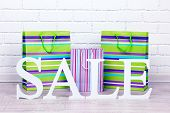 Sale with bags on floor on bright background