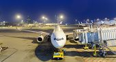 HONG KONG - APRIL 22: Airbus A330 docked in airport on April 22, 2014 in Hong Kong. Hong Kong International Airport  is one of the best airport in the annual passenger survey by Skytrax.