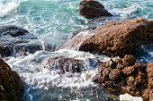 Sea waves rolling on stones