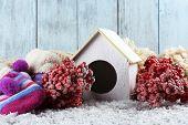 Handmade birdhouse in winter