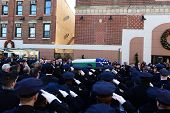 Saluting flag-draped coffin outside church