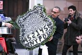 Floral arrangement with Ramos's badge number