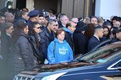 Mourners file out of church
