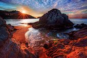 picture of incredible  - Incredible ocean bay with interesting boulders and distant cliffs and cloud formations - JPG