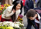 Man Buying Flowers For His Girlfriend At Flower Shop