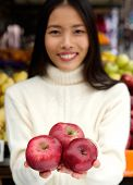 Smiling Young Woman Holding Fresh Organic Red Apples In Hand