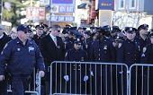NYPD officers behind barrier