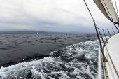 Sailing yacht on the race in a stormy sea. Sailing. Luxury yachts.