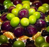 Fragment Of Fruity Cake With Grapes In Jelly With Syrup
