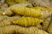 old bobbin with yellow jute rope