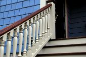 stock photo of staircases  - Newly restored staircase and railings that lead one to the home - JPG