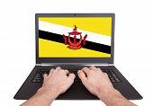 Hands Working On Laptop, Brunei