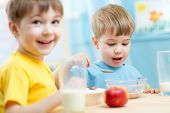 kids eating healthy food in kindergarten