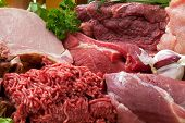 picture of meats  - Fresh Raw Meat Background with Smoked Pork Chops Beef Meat Turkey and ground beef - JPG