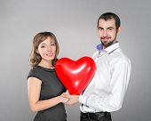 Couple With Heart Balloon Between Them