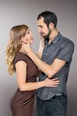 Embracing Couple In Love Posing At Studio