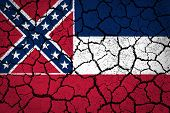 Mississippi flag painted on cracked ground