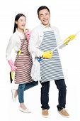 Man And Woman Holding Cleaning Supplies
