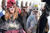 Masked Woman Walking In Venice