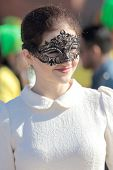 Elegant Masked Young Woman Dressed In White And Black During The Carnival Of Venice
