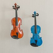 Blue And Brown Violins Hang On Wall