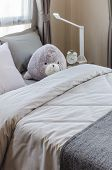 Doll On Bed In Bedroom
