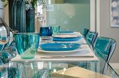 Table Set On Glass Table In Dinning Room