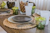 Table Set On Wooden Table In Dinning Room At Home
