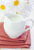 image of lactating  - milk in white jug and on a table - JPG