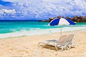 Chairs And Umbrella At Tropical Beach