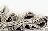 picture of brainwashing  - newspapers with abstract wavy formation closeup over white - JPG